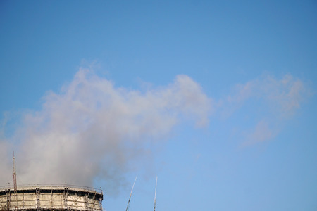 polluting: the industrial chimneys emits toxic pollutants into the sky polluting the environment