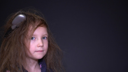 portrait unhappy girl with messy hair. Imagens
