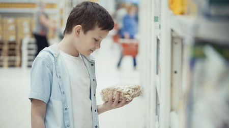 Boy in the shop choosing food.