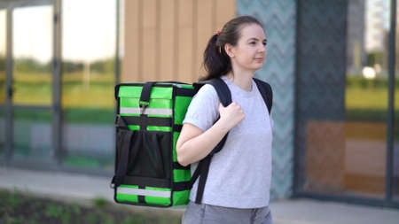 woman works as a food delivery courier is delivering an order