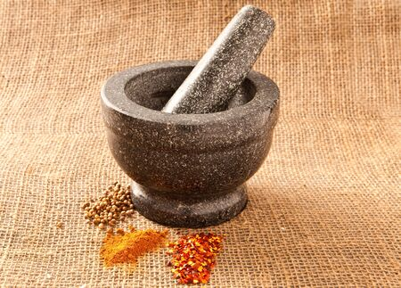 pestle and mortar on hessian photo