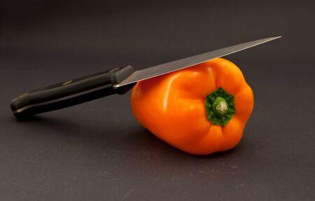 orange bell pepper and knife photo