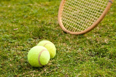 Tennis raquet and balls Stock Photo