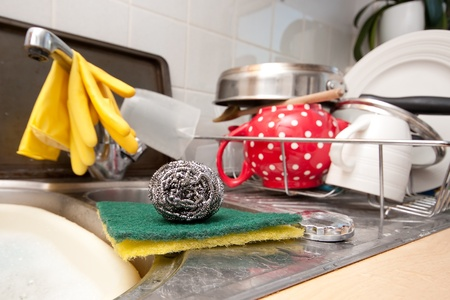 Scourer and scrubbing pads in a domestic kitchen photo
