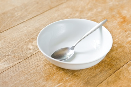 Breakfast bowl and spoon on a rustic wooden table top Stock Photo - 10041032