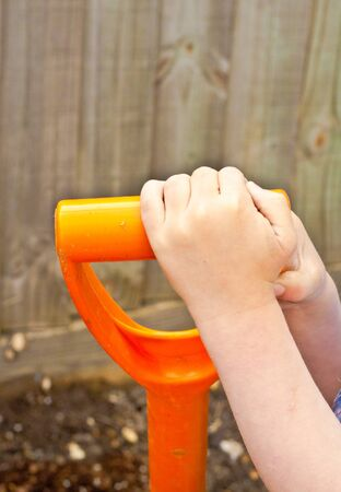 Childs hands gardening photo