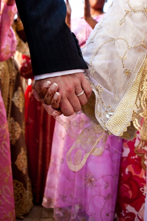 clasping: wedding couple hands Stock Photo