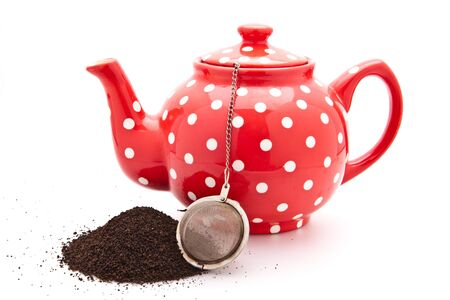 red colorful teapot photo