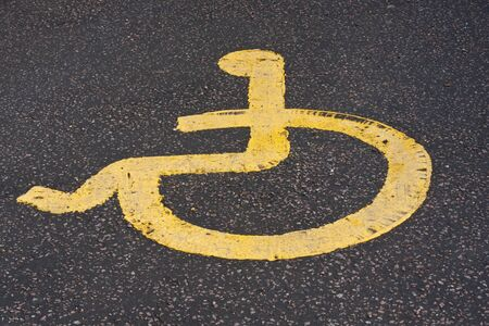 paralysis: yellow disabled sign Stock Photo