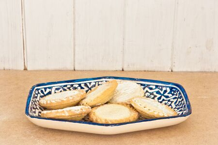 Gringe vintage style image of a plate of mince pies Stock Photo