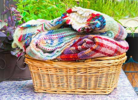Lovely soft woolen blankets in a basket in the garden Stock Photo - 10179859