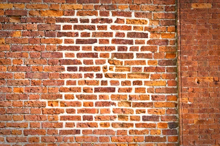 Unusual pattern in a red brick wall Stock Photo - 10654538