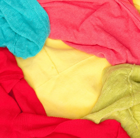 A background composed of colorful womens clothes in a pile for washing Stock Photo - 10654475