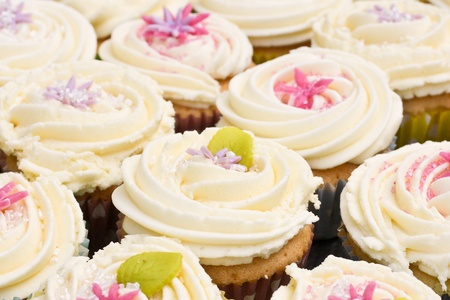 Assortment of freshly bakes cupcakes with buttercream icing