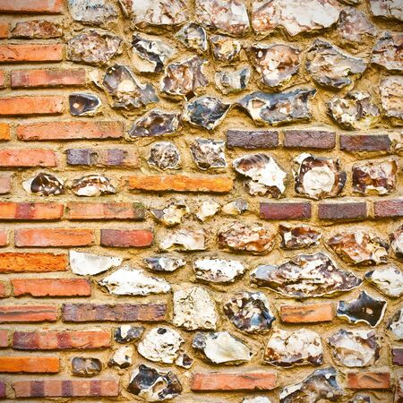 An interesting detailed sqaure background image of a flint and brick wall photo