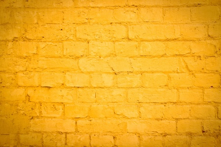 painted wall: Vibrant yellow brick wall as a background image with vignette