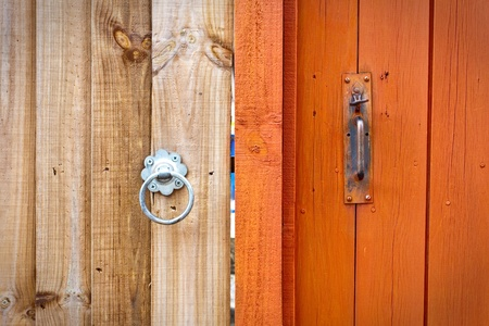 neighbours: Two neighbouring garden gates in different tones and different styles Stock Photo