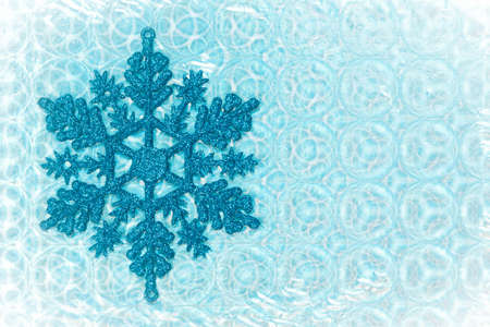 themed: Nice cold toned image of a snow flake on a patterned background