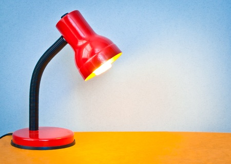 Lovely colorful image of a desk lamp shining onto a surface photo