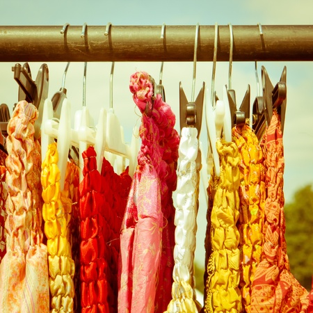 Colorful dresses for sale at and english country market Stock Photo