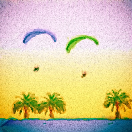 Digital canvas painting of parachutes above a tropical beach photo