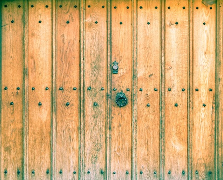 An old wooden door with wrought iron handle Stock Photo - 12116260