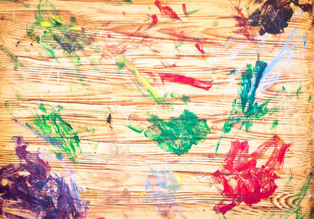 mixture: Dabs of paint on a wooden artists board