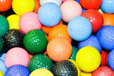 blue ball: Close up of a pile of multi-colored golf balls Stock Photo