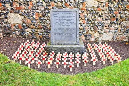 Bury St Edmunds, UK - NOVEMBER 5 2011: Poppy crosses are arranged in front of the Dunkirk Veterans association memorial stone in the Abbey Gardens, marking remembrance sunday on November 5, 2009 in Bury St Edmunds, UK.