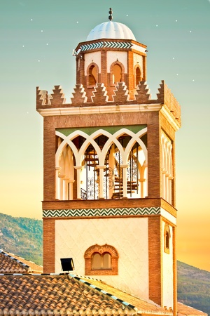 prayer tower: Minaret of a traditional moorish mosque in Spain at dusk
