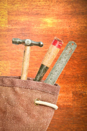 hessian bag: Old fashioned wood working tools in a hessian bag