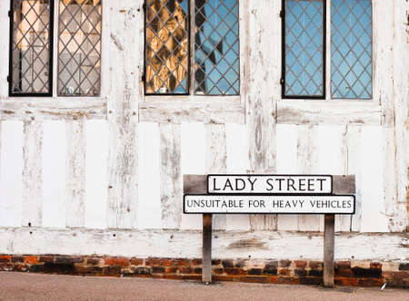 Street name and a road sign outside an old building in Lavenham, Suffolk, UK photo