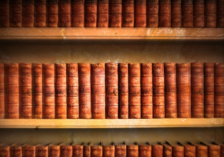 Collection of old weathered books in vintage tones photo