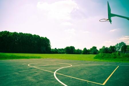 A basketball court in striking dramatic colours