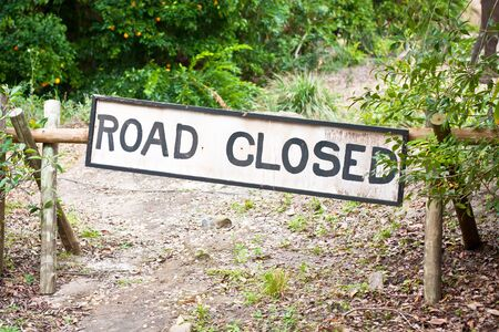 blockade: Road closed sign in a rural location