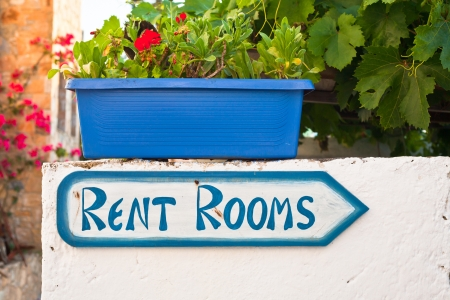 Sign for holiday accommodation in a Greek village Stock Photo