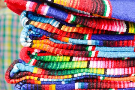 Pile of colorful mexican blankets for sale in a a market Stock Photo - 14568477