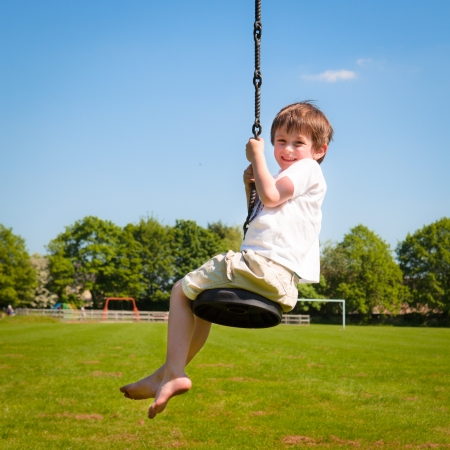 A young boy playing on a zip wire photo