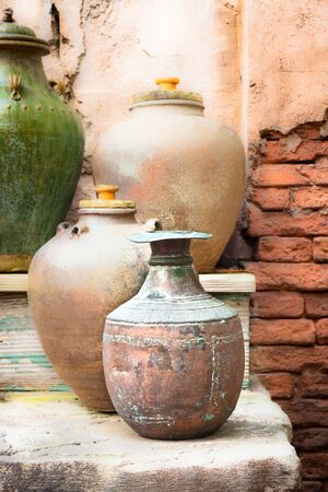 Collection of vintage urns and pots in a courtyard photo
