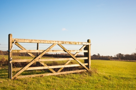 open country: An open gate on farmland in England