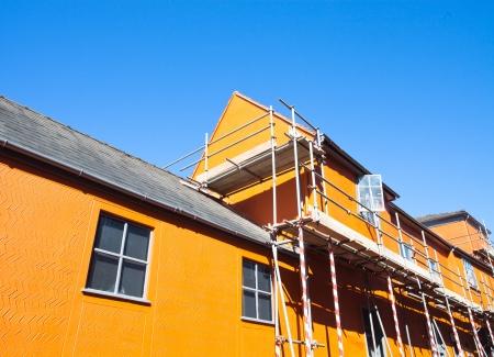 Scaffolding on an orange town building in Suffolk, UK