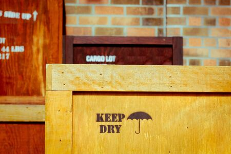 wooden lid: Wooden cargo crates stacked in a warehouse