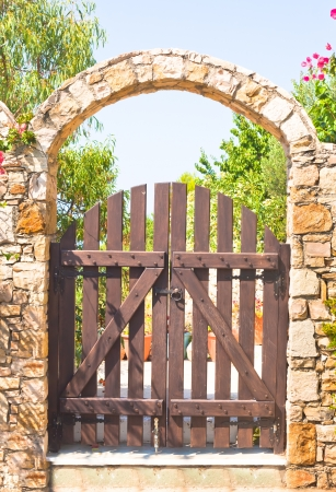 A nice stone arch gateway in a greek villa photo
