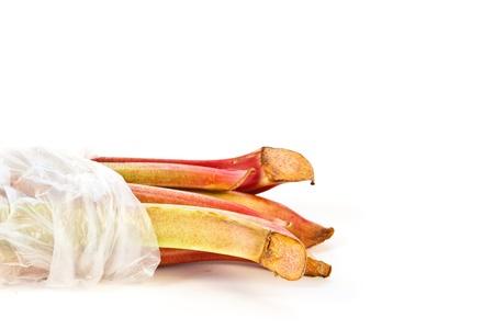 Bag of rhubarb  isolated on white background photo