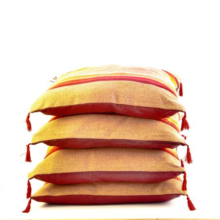 A stack of colorful moroccan cushions on a white background Stock Photo - 15065185