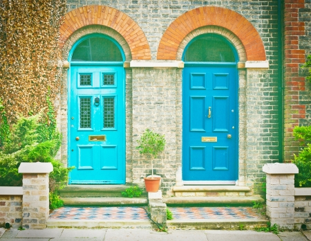 Pair of blue front doors of victorian houses in the UK