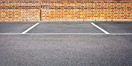 An empty car parking space in a modern parking lot photo