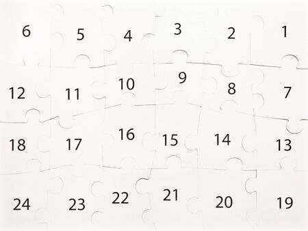 intact: Numbers on an intact jigsaw puzzle as a background Stock Photo