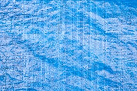 tarpaulin: Close up of a blue tarpaulin as a background image