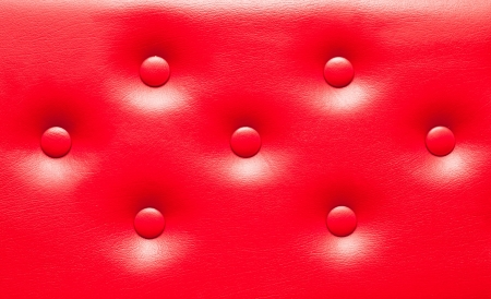 New red leather upholstery as a background image photo